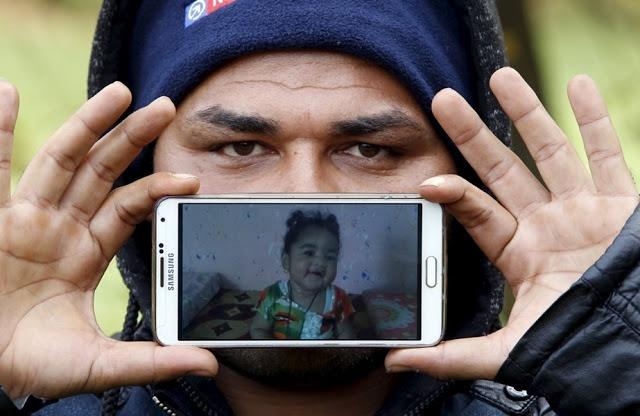Назар из Ирака, со своей дочкой