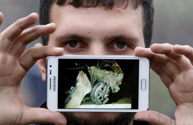 Осман из Сирии, с фотографией своей уничтоженной машины